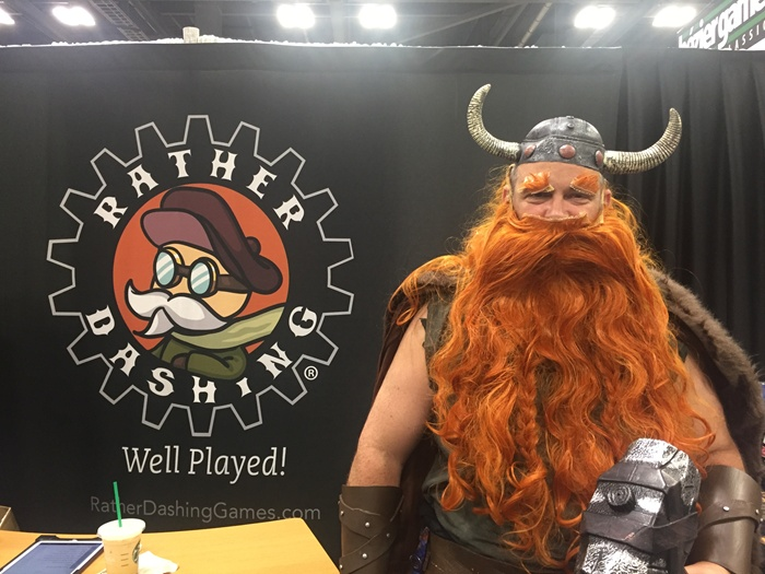 A visitor to Rather Dashing's booth at Origins Game Fair
